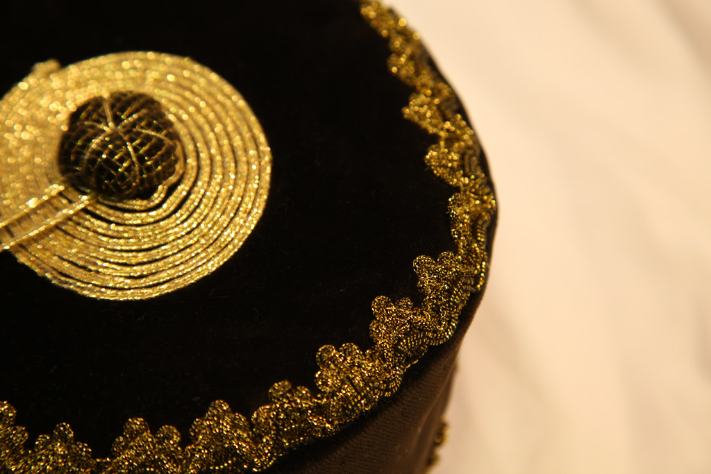 Royal in black with gold braid